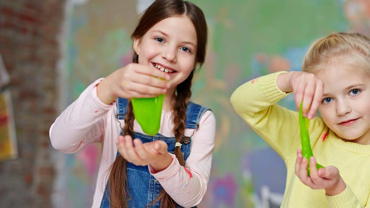 2 girls playing with green slime